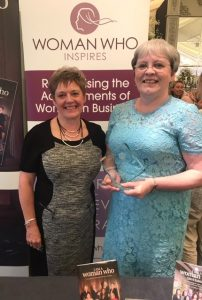 WomanWho Achieves win for Elaine